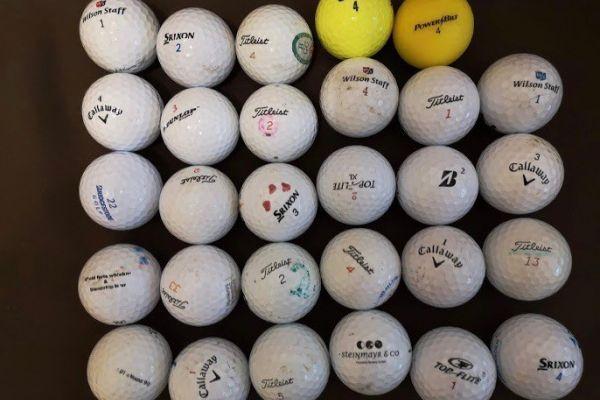 31 Stk verschiedene Golfbälle